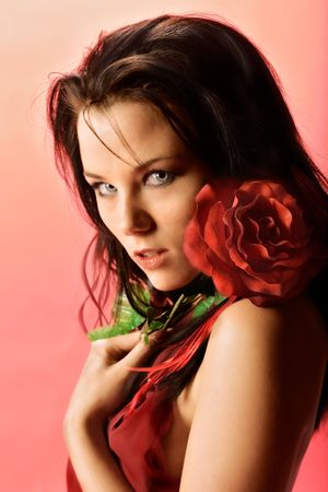 Romantic shot of model with red flower Stock Photo - 716325