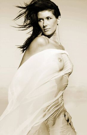 model in sheer cloth on beach