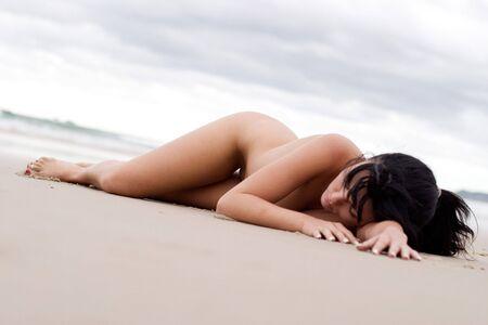 Nude woman laying on beach Stock Photo - 801687