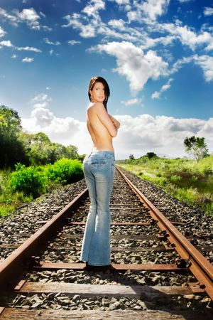 Topless model poses on train tracks Stock Photo - 801692