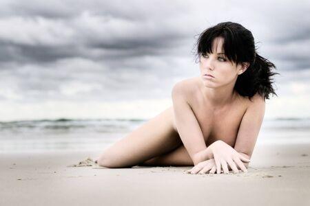 Beautiful girl laying on beach Stock Photo - 801694