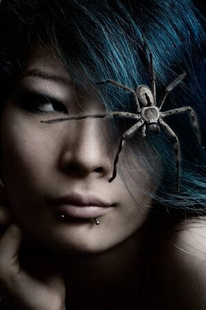 Portrait of model with spider in hair photo