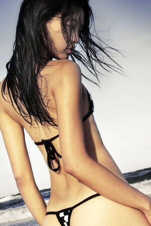 sexual girl: Asian model in swimsuit at the beach Stock Photo