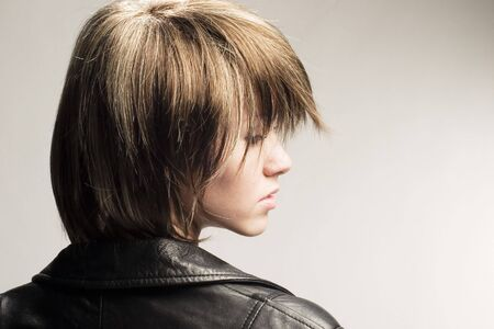 bob: Studio profile shot of girl in leather jacket