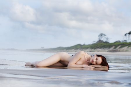 Naked woman laying on beach Stock Photo - 1230588