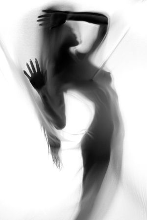 Anonymous  of girl silhouetted behind sheer cloth