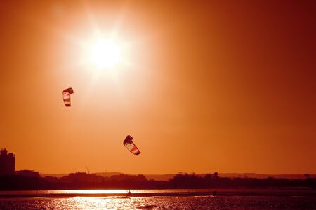 boarders: A pair of kite boarders at sunset