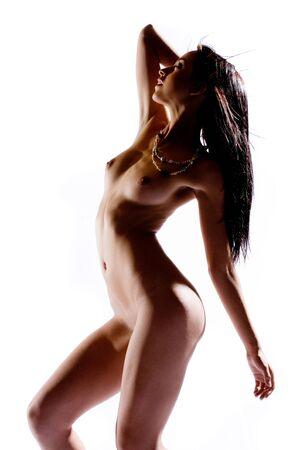 semi nude: Semi silhouette of nude woman in studio