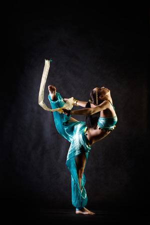 arab adult: Dancing girl in fantasy arabian harem costume Stock Photo