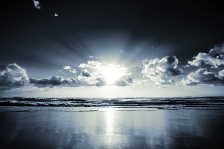 Morning sun bursts through clouds on a beach Stock Photo - 1471332