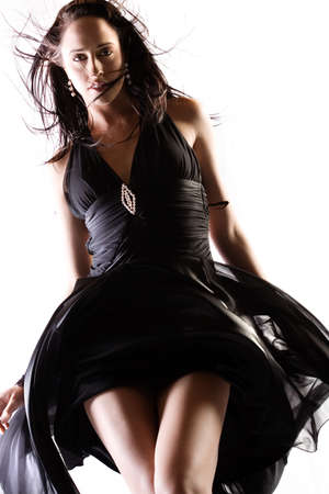 billow: Fashion model in studio with billowing dress Stock Photo
