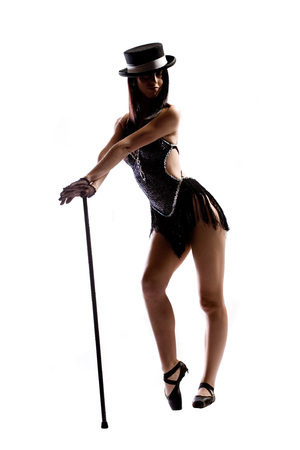 Woman in black ballet shoes, cane, hat and costume isolated on white Stock Photo