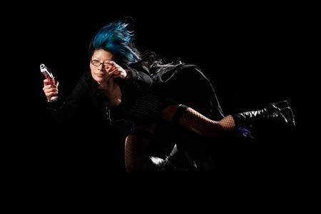 Girl jumping with gun Stock Photo - 1533603