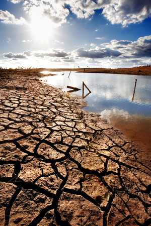 due: Lake bed drying up due to drought Stock Photo