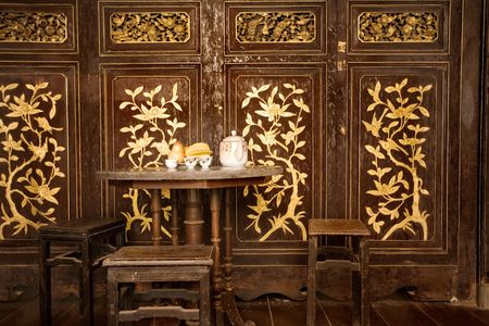 inlay: Chairs and table with tea set in Chinese setting