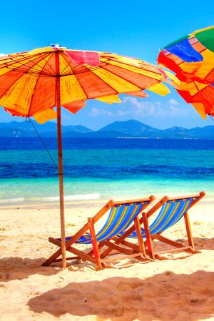 beach chairs: Deck chairs overlooking tropical waters of Thailand beach