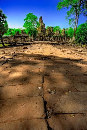 angor: Roadway leading to ruins of temple in Cambodia