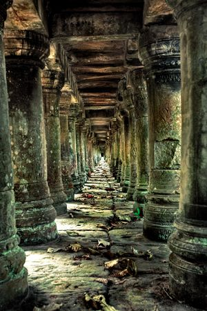 buddhist structures: Long corridor of pillars in temple ruins Stock Photo