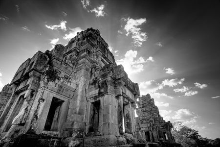 buddhist structures: Ruins of Asian Ankor temple in Cambodia in black & white Stock Photo