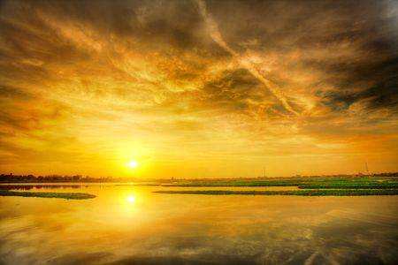 Sunset over lake in Phnom Penh (Cambodia) Stock Photo - 2283113