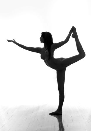 nude gymnast: Silhouette of nude gymnast in extreme pose