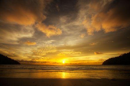 Golden sunset over South East Asian beach Stock Photo - 2596968