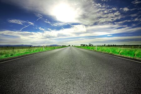 Long straight road stretches out ahead of viewer Stock Photo - 2966602