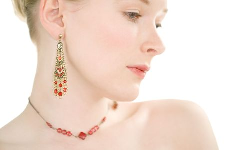 earing: Face shot of beautiful pale skinned young woman
