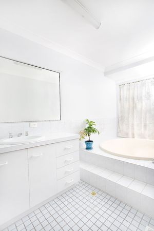 clean bathroom: Brightly lit airy bathroom with white tiles LANG_EVOIMAGES