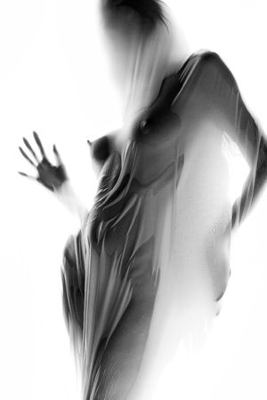 nude art model: Silhouette of naked girl behind white cloth LANG_EVOIMAGES