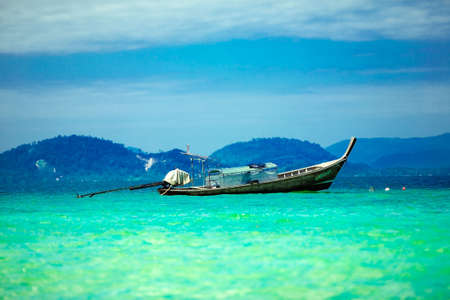 long tailed boat: Long tailed boat in tropical waters of Thailand LANG_EVOIMAGES