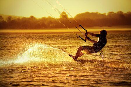 kite surf: Kite boarder on ocean at sunset - sport