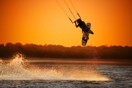 kite surf: Kite boarder performing a jump at sunset