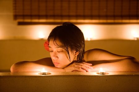 bathing beauty: Beautiful Chinese woman bathes in luxury spa LANG_EVOIMAGES