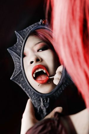 A vampire puts her makeup on for the night Stock Photo - 2966735