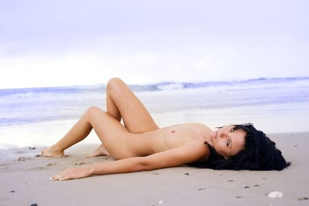 Nude woman on beach smiles at camera Stock Photo - 3012173