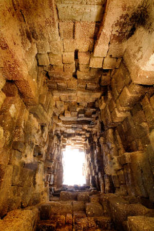 antique: Dooryway through Cambodian temple ruins to beyond LANG_EVOIMAGES