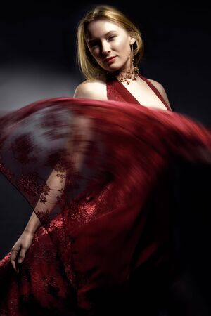 swish: Blonde fashion model on black studio background