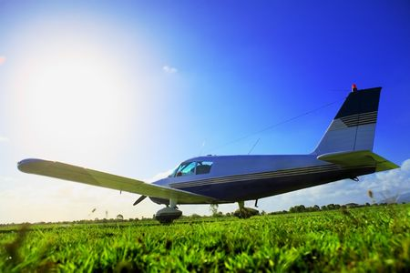 small plane: Small plane on grass field