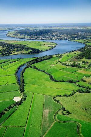 farmlands: Aerial landscape shot of sugarcane farms and river LANG_EVOIMAGES