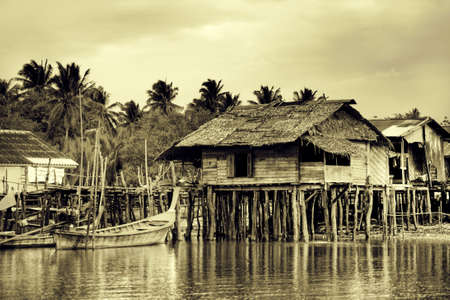 fishing village: Wooden shanties built along a river in Asia