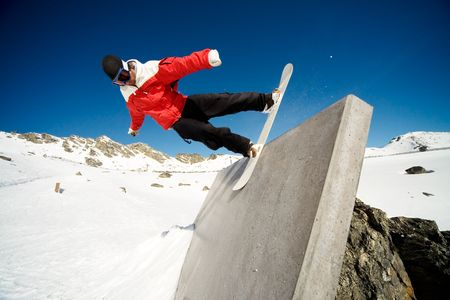 Snowboarder doing trick on wall ride, blue sky background Stock Photo - 3641425