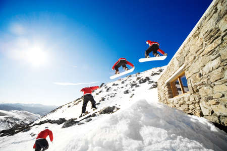 Sequence shot of snowboarder jumping off cabin roof Stock Photo - 3641422