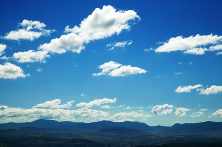 sky clouds: Background of deep blue sky and clouds above horizon LANG_EVOIMAGES