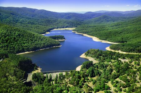 Aerial photo of dam in between mountains Stock Photo - 3641740