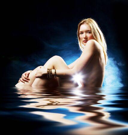 Pale blonde beauty in studio naked wearing jewellery Banco de Imagens
