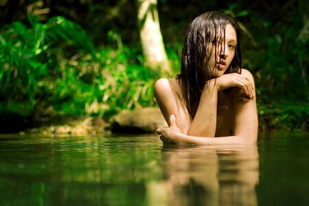 Beautiful girl bathes nude in forest stream Stock Photo - 4359998