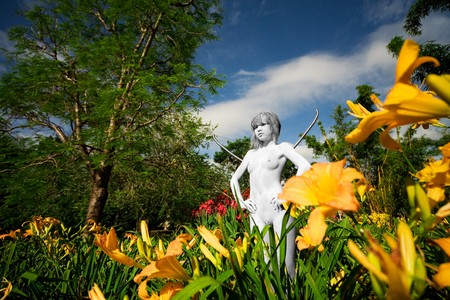 girl painted as statue in green garden with flowers Stock Photo - 4360013