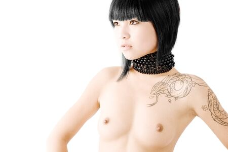 Asian fashion model with snake tattoo and beads around neck Stock Photo - 4360000