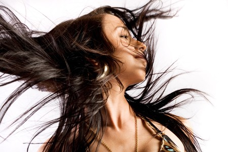 Woman with hair billowing on white background Stock Photo - 4373394